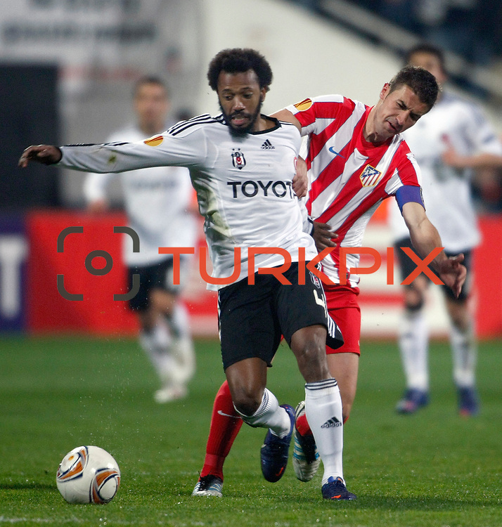 Besiktas's Manuel Fernandes (L) during their UEFA Europa League Round of 16, Second leg soccer match Besiktas between Atletico Madrid at Inonu stadium in Istanbul Turkey on Thursday March 15, 2012. Photo by TURKPIX