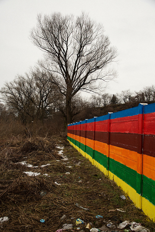 Recently painted wall in the Roma settlement in Ostrovany, Slovakia.