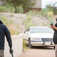 Sgt. Anthony Seciwa, right, participates in reality based training called Response to Resistance, Wednesday, August 28 by the Gallup Police Department. Officers participated in different scenarios, this scenario has the police officer responding to a call of a disorderly male.