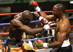 Daniel Wanyonyi (R) of Kenya punch Baraka Mwakasopa of Tanzania to win the Super Middle weight on a TKO during their Mac Series Professional Boxing Bonaza at Safaricom Indoor Arena in Nairobi on November 5, 2016. Wanyonyi won on a TKO. Photo/Fredrick Onyango/www.pic-centre.com (KEN)