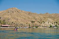 Kayaker paddles towards Willow Beach, The Black Canyon, Nevada.