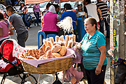 A Mexican woman selling bread along the road in Quiroga, Michoacan, Mexico.