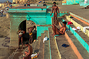 Kushti wrestlers after bathing in the Ganges following their dawn sesssion.