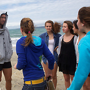 Quade Cooper talks to local children during the Australian teams recovery session at  Takapuna Beach at the IRB Rugby World Cup tournament, Auckland, New Zealand, 17th October 2011. Photo Tim Clayton...