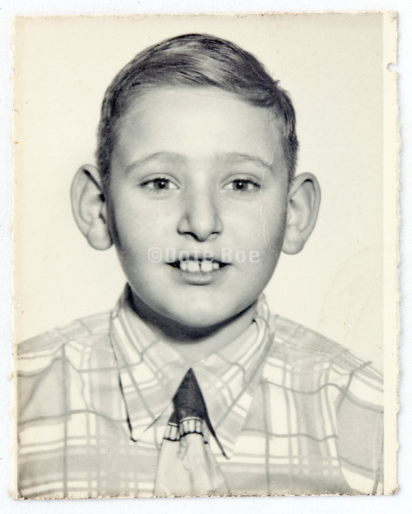 portrait photo of young boy with face straight at the camera