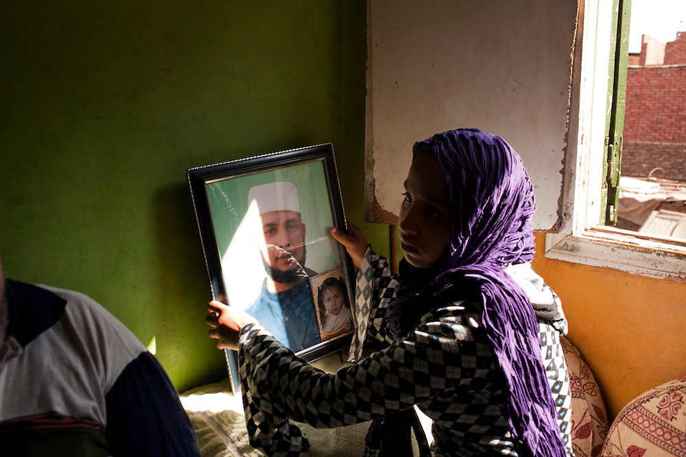 Jehad Adel, 18, pictured in her grandparents' house, where she has lived since her father was incarcerated and her mother abandoned her and her two younger siblings last year.  In the opening days of the revolution, Jehad's father was shot dead while in jail during a rash of shootings in the country's prisons that left over 100 dead.  Though the reason behind the shootings remains unclear, Jehad and her grandparents continue to demand justice, working with the Egyptian Initiative for Personal Rights to bring his case to court.