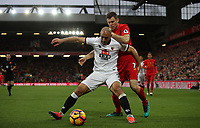 Football - 2016 / 2017 Premier League - Liverpool vs. Watford<br /> <br /> James Milner of Liverpool and Miguel Angel Britos of Watford during the match at Anfield<br /> <br /> COLORSPORT/LYNNE CAMERON
