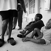 WEST PALM BEACH, FL - September 6, 2005:  A evacuee family passes time outside their room at a shelter for hurricane survivors on Sept 6, 2005 in West Palm Beach, Florida. Rosa Angelatta, white t-shirt, her daughter Sandra Smith (in red) and Angelatta's grandson, Kenneth, 11, playing with Sandra's niece, Eleanora, 5. (Photo by Todd Bigelow/Aurora)