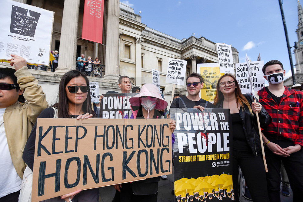 """© Licensed to London News Pictures. 17/08/2019. LONDON, UK.  Demonstrators in Trafalgar Square take part in a rally to show solidarity with the people of Hong Kong.  Similar """"Global Solidarity with Hong Kong"""" rallies are taking place worldwide as protests in the former British colony enter their tenth week demanding democratic reforms and a halt to police brutality.  Photo credit: Stephen Chung/LNP"""