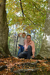 Father and son in forest, smiling, Bavaria, Germany