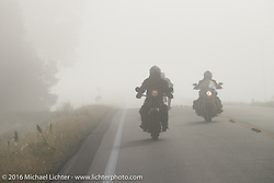 Llicensed Harley-Davidson artist Scott Jacobs on his 1926 Harley-Davidson in the fog at the beginning of Stage 8 of the Motorcycle Cannonball Cross-Country Endurance Run, which on this day ran from Junction City, KS to Burlington, CO., USA. Saturday, September 13, 2014.  Photography ©2014 Michael Lichter.