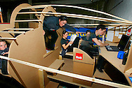 Multiple exposure photograph of yactswoman Ellen MacArthur sitting in a mocked-up version of the cramped living space aboard her 75ft solo triamaran in Cowes, Isle of Wight, before it is constructed.