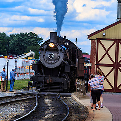 Strasburg, PA / USA - June 27, 2017:  A steam locomotive returns to the station from a passenger excursion in rural Lancaster County, Pennsylvania.