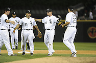CHICAGO - JUNE 07:  Gordon Beckham #15, Omar Vizquel #11, Brent Morel #22 and Mark Teahen #23 of the Chicago White Sox celebrate after the game against the Seattle Mariners on June 7, 2011 at U.S. Cellular Field in Chicago, Illinois.  The White Sox defeated the Mariners 5-1.  (Photo by Ron Vesely)  Subject:  Omar Vizquel;Brent Morel;Mark Teahen;Gordon Beckham..