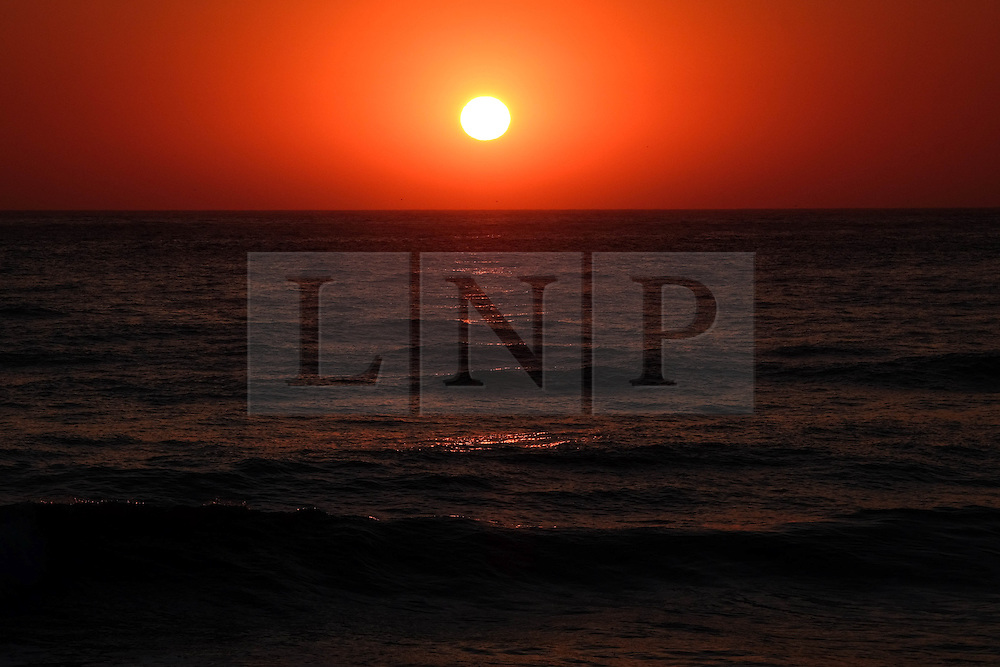 © Licensed to London News Pictures. <br /> 09/05/2016. <br /> Saltburn by the Sea, UK.  <br /> <br /> The sun rises over the North Sea horizon at Saltburn by the Sea in North Yorkshire. After the warmest day of the year yesterday temperatures are due to drop slowly over the rest of the week.<br /> <br /> Photo credit: Ian Forsyth/LNP