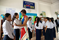 First Lady Michelle Obama and First Lady Bun Rany of Cambodia  greet students during a Room to Read event in support of the Let Girls Learn initiative, at Hun Sen Prasat Bakong High School in Siem Reap, Cambodia, March 21, 2015. (Official White House Photo by Amanda Lucidon)<br /> <br /> This official White House photograph is being made available only for publication by news organizations and/or for personal use printing by the subject(s) of the photograph. The photograph may not be manipulated in any way and may not be used in commercial or political materials, advertisements, emails, products, promotions that in any way suggests approval or endorsement of the President, the First Family, or the White House.