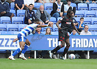 Bolton Wanderers' Clayton Donaldson under pressure from Reading's Liam Moore<br /> <br /> Photographer Kevin Barnes/CameraSport<br /> <br /> The EFL Sky Bet Championship - Reading v Bolton Wanderers - Saturday 18th August 2018 - Madejski Stadium - Reading<br /> <br /> World Copyright © 2018 CameraSport. All rights reserved. 43 Linden Ave. Countesthorpe. Leicester. England. LE8 5PG - Tel: +44 (0) 116 277 4147 - admin@camerasport.com - www.camerasport.com