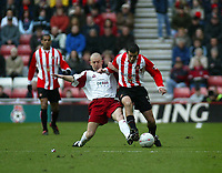 Photo. Andrew Unwin.<br /> Sunderland v Sheffield United, FA Cup Sixth Round, Stadium of Light, Sunderland 07/03/2004.<br /> Sunderland's Julio Arca (r) is tackled by Sheffield United's Robert Page (l).