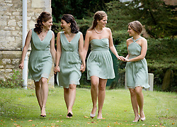 © London News Pictures. 14/09/2013.  Bridesmaids in the grounds of the church at  the wedding of Euan Blair, Son of former British Prime Minister Tony Blair,  to Suzanne Ashman at All Saints Parish Church in Wotton Underwood, Buckinghamshire. The wedding was attended by Former British Prime minister Tony Blair and his wife Cherie Blair. Photo credit: Ben Cawthra/LNP