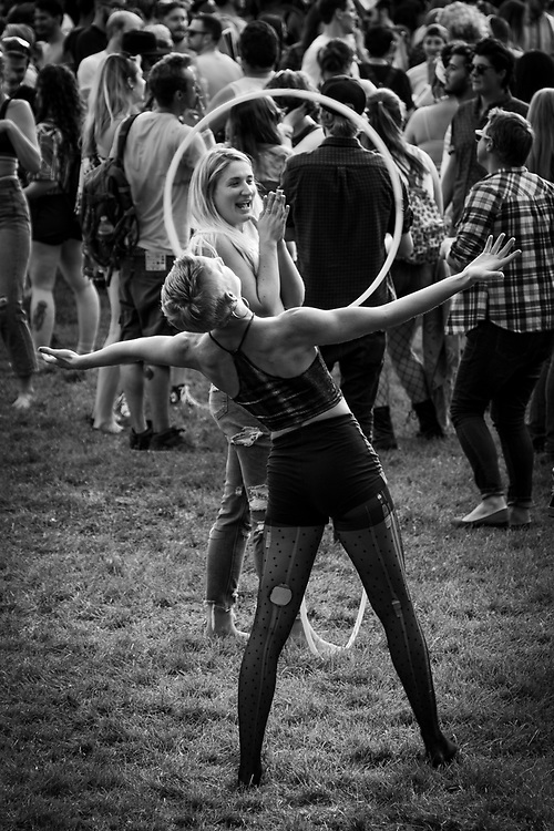 A woman performs with a Hula Hoop in a Felliniesque scene at the Denver PrideFest.