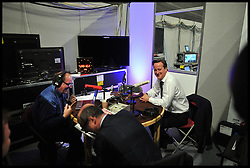 David Cameron during a radio interview with James Naughtie and Nick Robinson for BBC News during the Conservative Party Conference at ICC, Birmingham, on the second day of the Party Conference, Tuesday October 9, 2012. Birmingham, England. Photo by Andrew Parsons / i-Images..