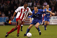 Fotball<br /> England 2004/2005<br /> Foto: SBI/Digitalsport<br /> NORWAY ONLY<br /> <br /> Stevenage v Rochdale<br /> FA Cup Second Round. 04/12/2004<br /> <br /> Paul Tate (Rochdale) moves in to tackle Barry Larker (Stevenage).