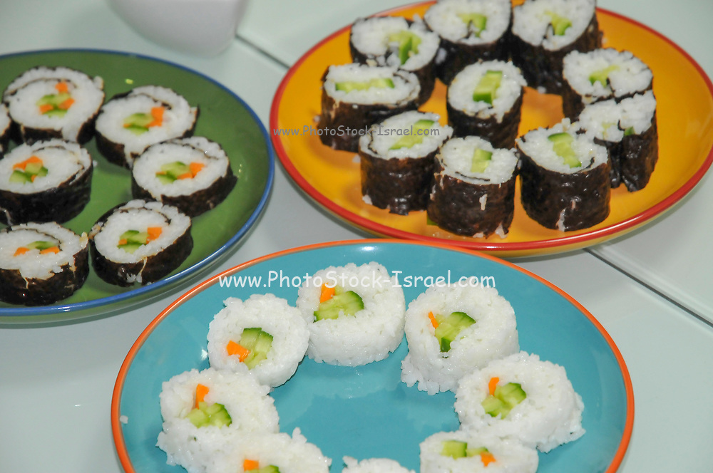 Platters of vegetarian sushi vegetables and rice wrapped in seaweed