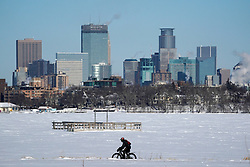 A cyclist decked out in cold weather gear rides past the city skyline and a frozen Bde Maka Ska on Jan. 30, 2019 in Minneapolis MN, USA. Photo by Anthony Souffle/Minneapolis Star Tribune/TNS/ABACAPRESS.COM