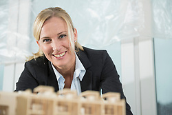 Female architect with architectural model
