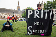 An activist holds a banner criticising Home Secretary Priti Patel at a Kill The Bill protest in Parliament Square against the Police, Crime, Sentencing and Courts PCSC Bill 2021 as MPs consider amendments to the Bill in the House of Commons on 5th July 2021 in London, United Kingdom. The PCSC Bill would grant the police a range of new discretionary powers to shut down protests, including the ability to impose conditions on any protest deemed to be disruptive to the local community, wider stop and search powers and sentences of up to 10 years in prison for damaging memorials.