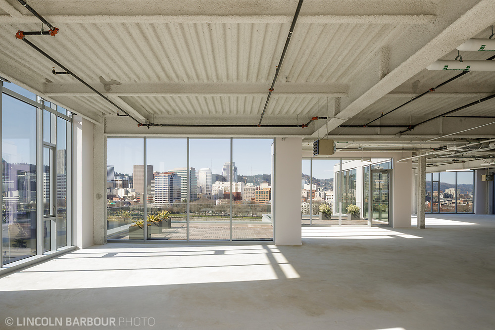 An empty, industrial commercial space in Portland, Oregon with a great view of the Willamette River and downtown.