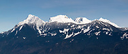 Fresh snow on the peaks of the Mount Cheam Range during late winter. The peaks are (from L to R):  Cheam Peak (Lhílheqey), Lady Peak, Knight Peak, and Welch Peak.  Photographed from Hillkeep Regional Park in Chilliwack, British Columbia, Canada.