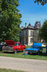 03 August 2013:  A Dodge pickup truck and a 1971 Plymouth GTX sit in front of the David Davis Mansion.<br /> <br /> Displayed at the McLean County Antique Automobile Association Car show at David Davis Mansion in Bloomington Illinois<br /> <br /> This image was produced in part utilizing High Dynamic Range (HDR) processes.  It should not be used editorially without being listed as an illustration or with a disclaimer.  It may or may not be an accurate representation of the scene as originally photographed and the finished image is the creation of the photographer.