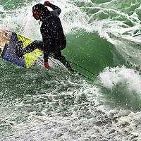 A surfer tames a foamy wall as a large swell pours into Steamer Lane in Santa Cruz, California.<br /> Photo by Shmuel Thaler <br /> shmuel_thaler@yahoo.com www.shmuelthaler.com