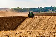 Tractor ploughing a wheat field, Negev Desert, Israel