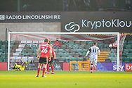 Lincoln City Jorge Grant (10) takes a penalty and scores a goal scores a goal 2-0 during the The FA Cup match between Lincoln City and Forest Green Rovers at Sincil Bank, Lincoln, United Kingdom on 7 November 2020.