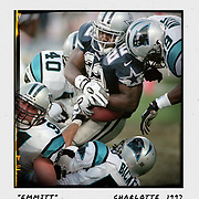 The Carolina Panthers slow down the Dallas Cowboys' Emmitt Smith during the 1997 division playoff game at Bank of America Stadium in Charlotte. The Panthers upset the Cowboys and headed to Green Bay the next week to play in the NFC Championship game. ©Travis Bell Photography