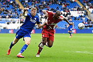Uche Ikpeazu (9) of Middlesbrough on the attack battles for possession with Mark McGuinness (2) of Cardiff City during the EFL Sky Bet Championship match between Cardiff City and Middlesbrough at the Cardiff City Stadium, Cardiff, Wales on 23 October 2021.
