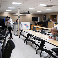 Erika Pirotte and Matt Shepherd cast their ballots at Fire Station No. 1 in Gallup Tuesday evening.