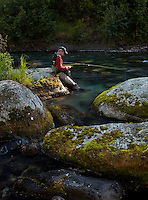 fly angler choosing a fly while fishing for rainbow trout, Indian River Alaska