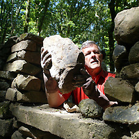 """Bryan Cooper works on a dry stone and Lime Motar Wall in the building of a house at the """"Summer in the Woods"""" festival in Tuamgraney, Clare on Saturday organised by CELT (centre for enviornmental living and training).Pic. Brian Arthur/ Press 22."""