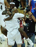 COPYRIGHT DAVID RICHARD.LeBron James jumps in to the arms of Cavaliers' veteran Zydrunas Ilgauskas after Cleveland's win over Detroit..Detroit Pistons at Cleveland Cavaliers in Game 6 of the NBA Eastern Conference Finals, June 2, 2007.
