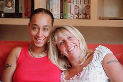 Portrait of lesbian couple smiling,