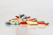 Assorted pills and medication on white background