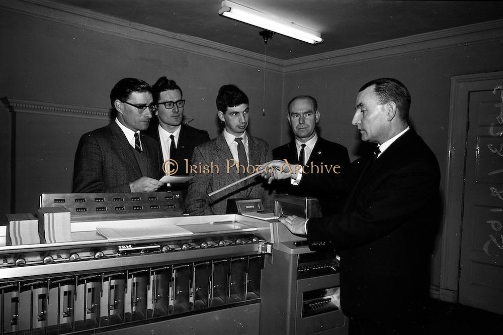 6/3/1965<br /> 3/6/1965<br /> 6 March 1965<br /> <br /> Mr. J.J. Jones Managing Director explaining data processing equipment to R. Keenan C.I.E Hugh O'Dobbell, Ian Philips and Brendan O'Connor