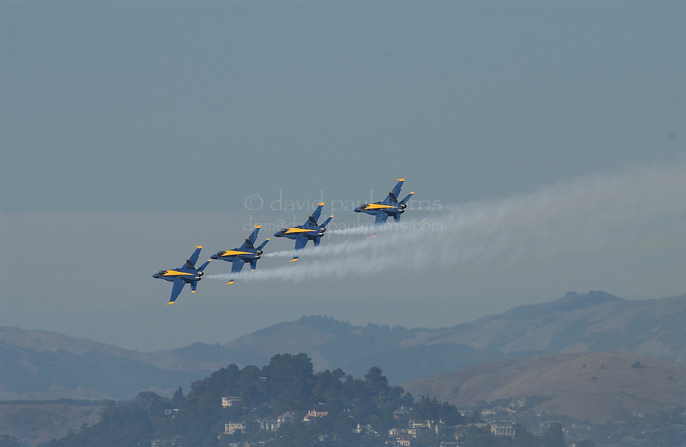 SAN FRANCISCO, CA:  The Blue Angels fly over North Beach in San Francisco, California. Photograph by David Paul Morris