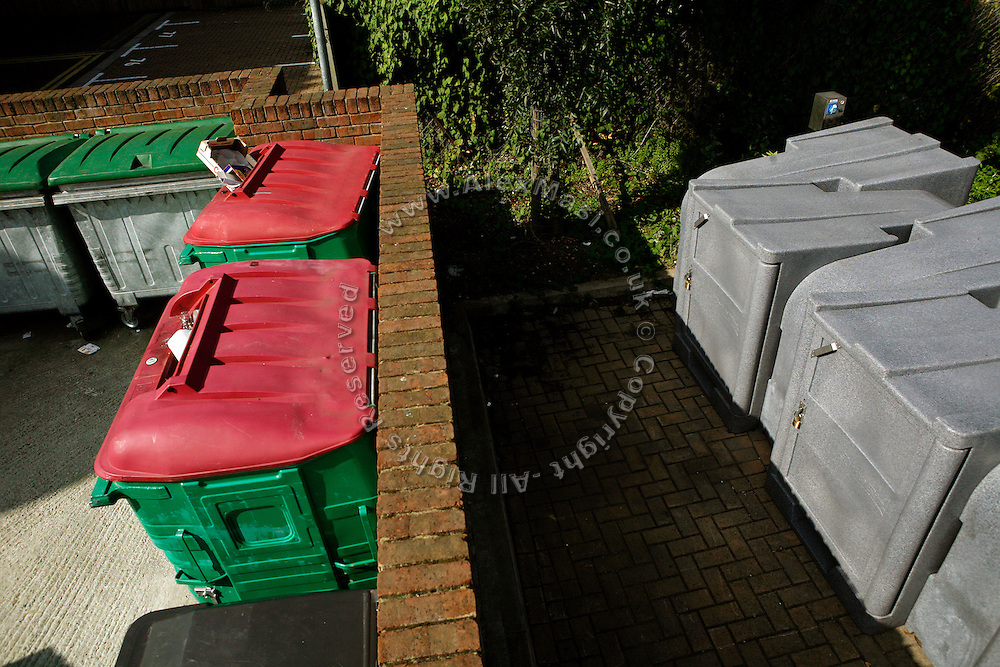 Recycling bins are located near bike locks in BedZED on Thursday, Sep. 6, 2007. BedZED or the Beddington Zero Energy Development, is an environmentally-friendly housing development near Wallington, England in the London Borough of Sutton. It was designed by the architect Bill Dunster who was looking for a more sustainable way of building housing in urban areas in partnership between the BioRegional Development Group and the Peabody Trust. There are 82 houses, 17 apartments and 1,405 square meters of work space were built between 2000. The project was shortlisted for the Stirling Prize in 2003. The project is designed to use only energy from renewable source generated on site. In addition to 777 square meters of solar panels, tree waste is used for heating and electricity. The houses face south to take advantage of solar gain, are triple glazed and have high thermal insulation while most rain water is collected and reused. Appliances are chosen to be water efficient and use recycled water wherever possible. Low impact building materials were selected from renewable or recycled sources and were all originating within a 35 mile radius of the site to minimize the energy required for transportation. Also, refuse collection facilities are designed to support recycling and the site encourage eco-friendly transport: electric and LPG cars have priority over petrol/diesel cars, and electricity is provided by parking spaces appositely built for charging electric cars.