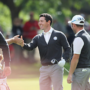 Ryder Cup 2016.  Rory McIlory of Europe is congratulated by team mates after his approach shot on the sixth went straight into the hole during practice day at the Hazeltine National Golf Club on September 29, 2016 in Chaska, Minnesota.  (Photo by Tim Clayton/Corbis via Getty Images)