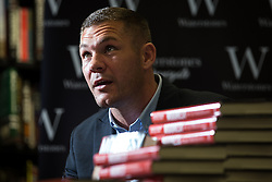"""© Licensed to London News Pictures . 09/07/2016 . Manchester , UK . Boxer JAMIE MOORE signs copies of his book """" Mooresy """" at Waterstones on Deansgate in Manchester City Centre . Photo credit : Joel Goodman/LNP"""