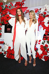 Australian Turf Club and Manning Cartell collaborate on a world-first fashion collection inspired by jockey silks. As Sydney super mare Winx aims for her 27th consecutive win and third title in the Group 1 $500,000 Colgate Optic White Stakes at Royal Randwick, supermodel Robyn Lawley was trackside taking in all the action racegoers can expect during the Australian Turf Club's 2018 Everest Carnival. Robyn showcased the first garment in the Everest Carnival Silks collection created in partnership with luxury Australian fashion house Manning Cartell. Australian Turf Club teamed up with Manning Cartell to create the bespoke collection of garments inspired by the striking patterns and bold colours of winning jockey silks. Robyn Lawley's Everest Carnival Silks dress is inspired by the pattern of Winx's winning jockey silks, with an exciting splash of Colgate's signature red. Additional garments from the Everest Carnival Silks collection will be showcased throughout Everest Carnival at De Bortoli Wines Golden Rose Day, TAB Epsom Day and Moët and Chandon Spring Champion Stakes Day. 15 Sep 2018 Pictured: Robyn Lawley, Jennifer Hawkins, Jen Hawkins. Photo credit: Richard Milnes / MEGA TheMegaAgency.com +1 888 505 6342